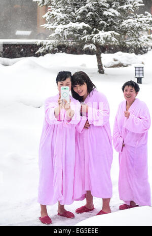 Changchun. 17th Feb, 2015. Tourists take selfie by the side of hot spring at Changbai Mountain Nature Reserve in - Stock Photo