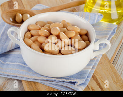 White beans on  wooden background. Selective focus - Stock Photo