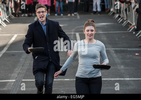 London, UK. 17th February, 2015.  The Better Bankside Annual Charity Pancake Race at Borough Market.  Credit:  Gordon - Stock Photo