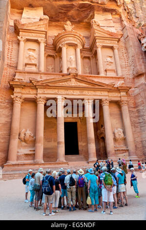 Crowds of tourists near the Treasury in the Ancient city of Petra carved out of the rock - Stock Photo