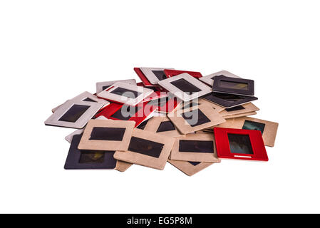 35 mm mounted film slides into the plastic and cardboard different colored frames isolated on white background - Stock Photo