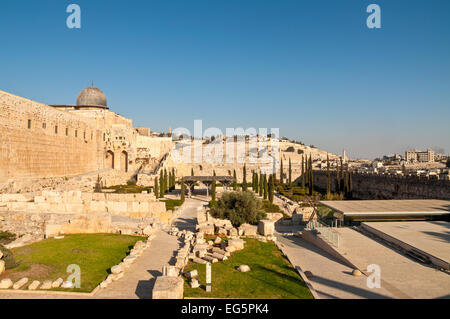This is a view of the Mount of Olives from the Temple Mount. A portion of the wall around the old city of Jerusalem - Stock Photo