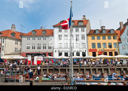 A lot of people visiting the Nyhave (meaning New Harbour) 17th century waterfront canal. - Stock Photo