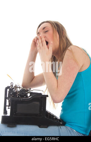 Girl tired on a typewriter isolated on a white background - Stock Photo