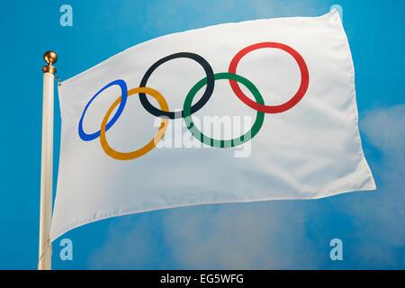 olympic flag flying - Stock Photo