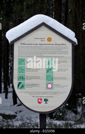 Information sign in the Harz National Park in the snow in winter, Saxony-Anhalt, Germany - Stock Photo
