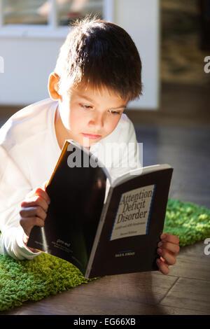 boy reading a book - Stock Photo