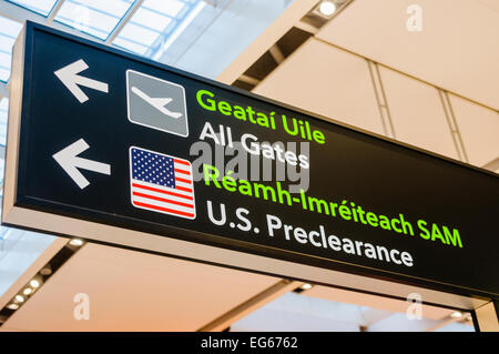 Sign in Dublin Airport directing passengers to US Preclearance - Stock Photo