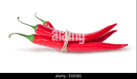 Three red chili peppers tied with a rope isolated on white background - Stock Photo