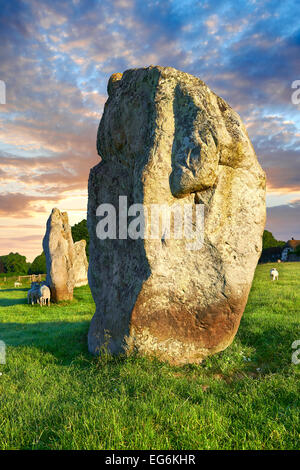Avebury neolithic standing stone circle, largest in England at sunset, A UNESCO World Heritage Site, Wiltshire, - Stock Photo