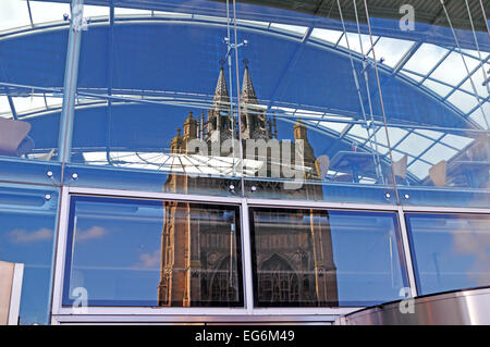 A reflection of St Peter Mancroft church tower in glass at The Forum, Norwich, Norfolk, England, United Kingdom.