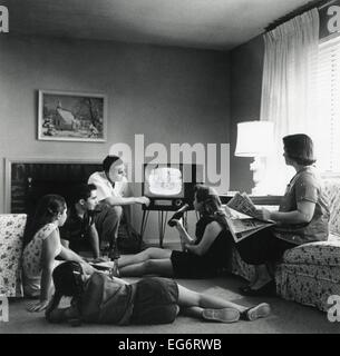 American family viewing television in the living room of their home. 1959. (BSLOC 2014 13 163) - Stock Photo