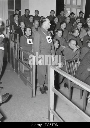 Josep Dietrich, Commander of the 6th Nazi SS Panzer Army, on trial for Malmedy Massacre. Standing with #11 hanging - Stock Photo