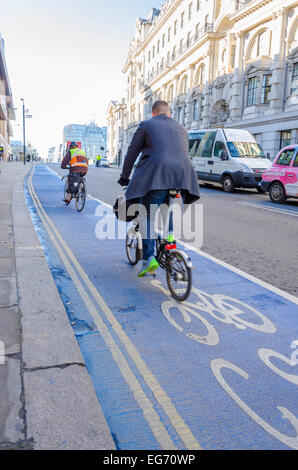 London, UK 17th February 2015: Cyclists on Cycle Superhighway 7 (CS7) on Queen Street Place heading towards Southwark - Stock Photo