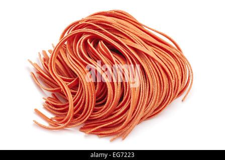 red fettuccine pasta on white - Stock Photo