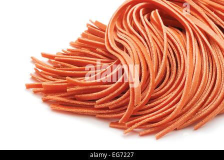 fettuccine red pasta on white - Stock Photo