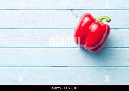 red pepper on kitchen table - Stock Photo