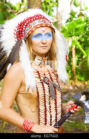 Native American, Indians in traditional dress, standing, rice field, day time, ax tomahawk - Stock Photo