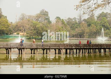 Local Burmese people walking on the bridge over Kandawgyi Lake, Yangon ( Rangoon ), Myanmar ( Burma ), Asia - Stock Photo