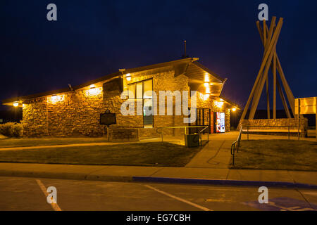 Rest area restroom plus accompanying structure with a tipi motif in an Interstate 90 at night, South Dakota, USA - Stock Photo