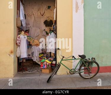 A bicycle outside a small shop in Trinidad, Cuba. - Stock Photo