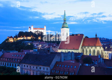 Cathedral, Castle and Old Town overview lit up at dusk, Bratislava, Slovakia - Stock Photo