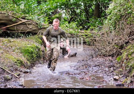 Bangor, Northern Ireland. 18th February, 2015. Soldiers from the Royal Irish Regiment run through a river Credit: - Stock Photo