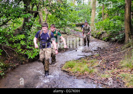 Bangor, Northern Ireland. 18th February, 2015. Soldiers run through a river during a cross-country exercise. Credit: - Stock Photo