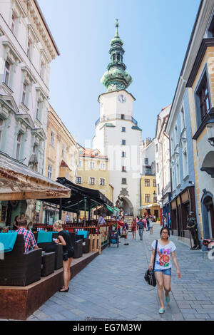 Michael's Gate and  people at Venturska Michalska the Old Town´s main street in Bratislava, Slovakia - Stock Photo