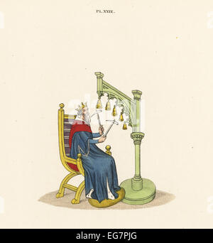 King David playing handbells with hammers from a 14th century manuscript of his psalms. - Stock Photo