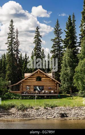 Log cabin home on the banks of the Chena River, Fairbanks, Alaska, USA - Stock Photo