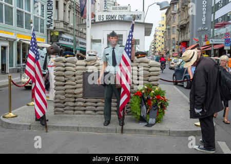 Relaxing American soldiers with American flag, Checkpoint Charlie toda,  Berlin, Capital of Germany, Europe. - Stock Photo