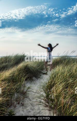 Woman rejuvenated by the coastal outdoors of Cape Cod, Massachusetts, USA - Stock Photo