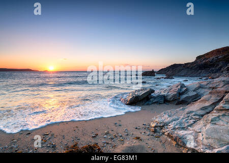Sunset over Little Fistral Beach at Newquay in Cornwall - Stock Photo