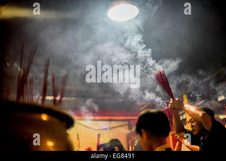 Jakarta, Indonesia. 18th Feb, 2015. People pray for protection and prosperity at Jin De Yuan temple in Jakarta on - Stock Photo