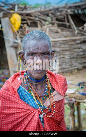 MASAI MARA, KENYA - September, 23: Old Masai woman on September, 23, 2008 in Masai Mara National Park, Kenya - Stock Photo