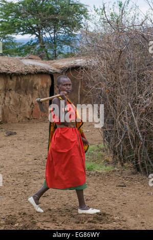 MASAI MARA, KENYA - September, 23: Young Masai woman with ax on September, 23, 2008 in Masai Mara National Park, - Stock Photo