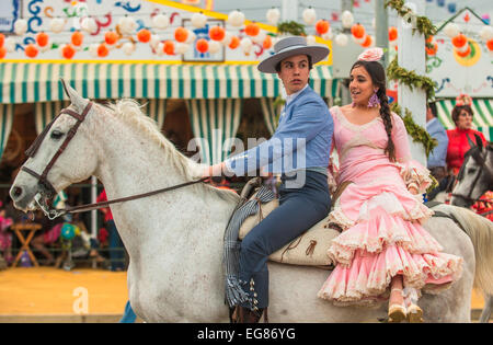 SEVILLE, SPAIN - April, 26: Horse riders at the Seville's April Fair on April, 26, 2012 in Seville, Spain - Stock Photo