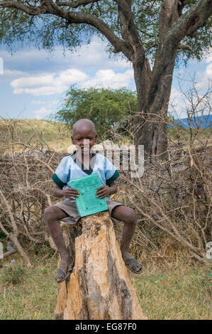 MASAI MARA, KENYA - September, 23: Masai boy on September, 23, 2008 in Masai Mara National Park, Kenya - Stock Photo