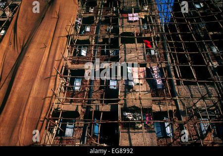 Multi storey modern Building with scaffolding in Mumbai,India,under maintenance - Stock Photo