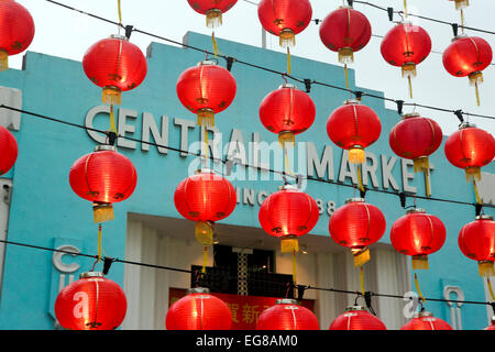 Red lanterns hanging outside the Central Market in Chinatown for Chinese New Year celebrations - Stock Photo