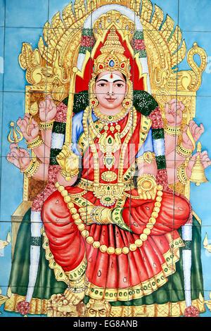 Mural of deity on wall tiles at Sri Mahamariamman Temple. - Stock Photo