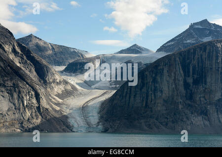 Baffin Island, Nunavut, Canada, showing glacier flowing into the sea, August - Stock Photo