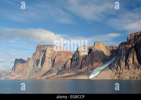 Baffin island, Nunavut, Canada, mountaineous coastline showing glacier flowing into the sea, August - Stock Photo