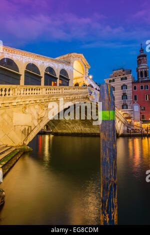 Rialto Bridge at dusk, Venice, Veneto, Italy - Stock Photo