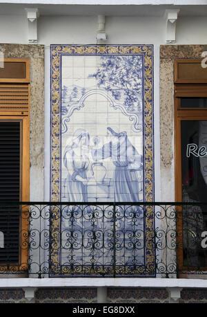 Azulejos on an Alfama Cafe building in Lisbon - Stock Photo