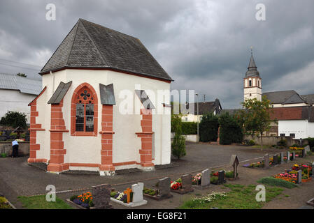 Graveyard chapel of Duppach in the Vulkaneifel district of the state of Rhineland-Palatinate, Germany. - Stock Photo