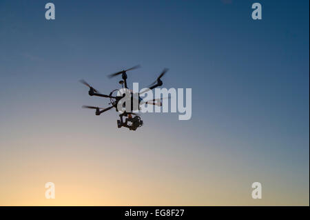 Drone flying and take off with operator - Stock Photo