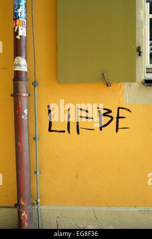 Graffiti the word Liebe, German for love, on wall in Freiburg im Breisgau, Germany - Stock Photo