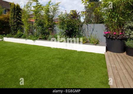 Artifical plastic fake lawn in English contemporary garden,Oxfordshire,England - Stock Photo